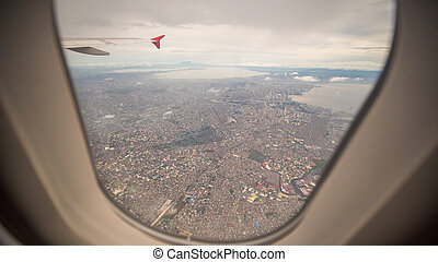View from the window of the plane to the city of Manila. Philippines.