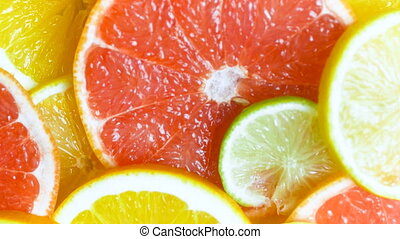 View from top of camera panning along assortment of citrus...