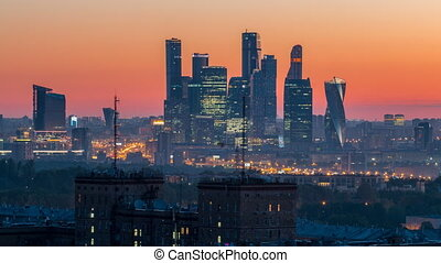 View from top of cityscape night to day timelapse, residential buildings, park areas, group of Moscow City skyscrapers in distance, horizon, morning mist before sunrise, Moscow, Russia