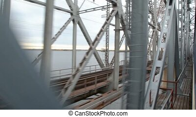 view from train moving on railway bridge with technical staff