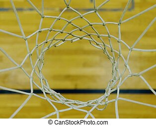 View from up through  basketball hoop, school sporting wooden board at the bottom
