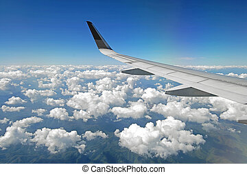 aircraft wing flying over beautiful clouds