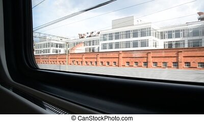 view from window of train in industrial suburb of Moscow, Russia