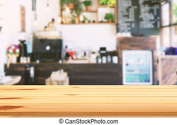 View from wooden table in coffee shop. blurred background