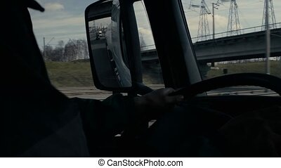 View in tank car's rearview mirror on highway - Passenger...