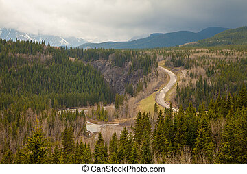 View in to a valley in the Rocky Mountains in Sheep River Provincial Park, Alberta