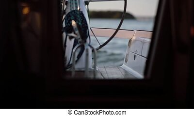 View inside a cabin of the ship. The captain driving the...