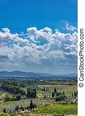View into Tuscany countryside with clouds in background