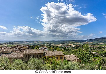View into Tuscany landscape over the roofs of old town