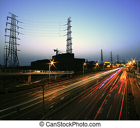 View long exposure photographs of urban night dusk Highway Traffic and transmission tower