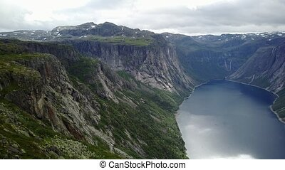View near Trolltunga to Fjord and water from drone on air...