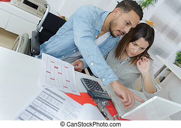 view of a attractive couple doing administrative paperwork