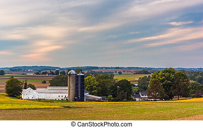 View of a barn and silos on a farm in rural Lancaster...