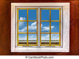 View of a blue sky and clouds through a window