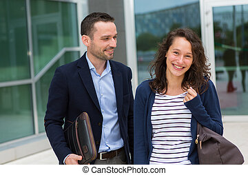 business man and woman chatting together after work