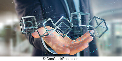 Businessman holding a 3d rendering blockchain cube isolated...