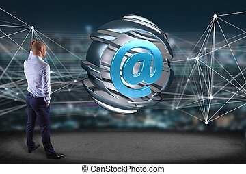 Businessman in front of an Arobase symbol displayed in a sliced sphere - 3D rendering