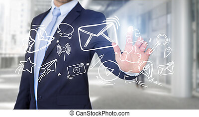 Businessman touching technology interface with Internet icons