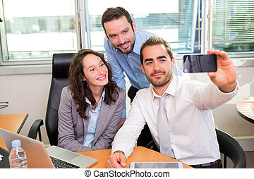 Group of business associates working together at the office...