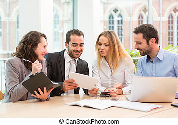 Group of business people working together at the office