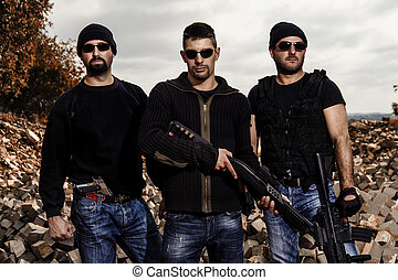 View of a group of gang members with guns.