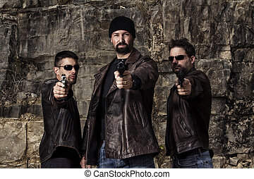 gang members with guns - View of a group of gang members...