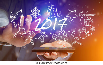 Hand of a man holding smartphone with 2017 icons all around
