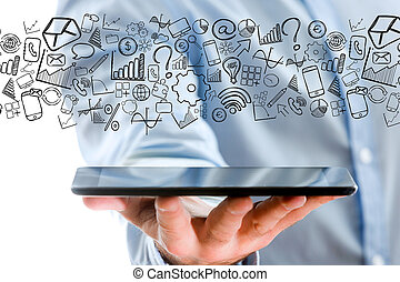Hand of a man holding tablet with business icons all around