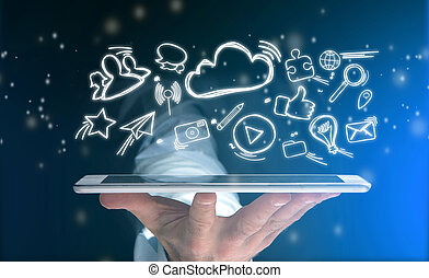 Hand of a man holding tablet with internet icons all around