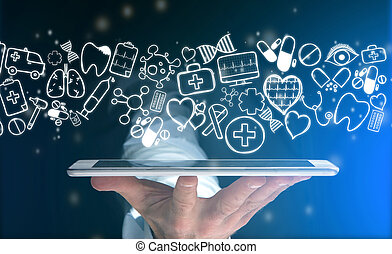 Hand of a man holding tablet with medical icons all around