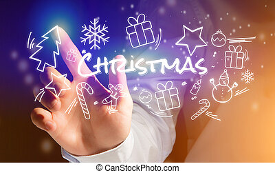 Hand of a man touching interface with christmas icon around