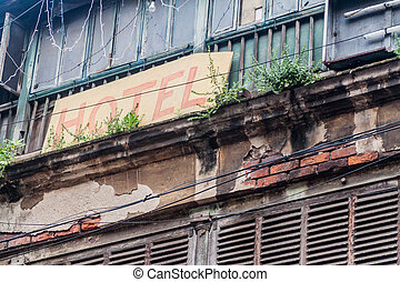 View of a Hotel sign on a dilapidated house in the center of Kolkata, Ind