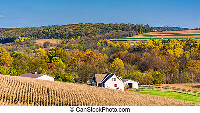 View of a house and rolling hills in rural York County, Pennsylvania.