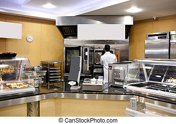 View of a kitchen with baker preparing breads and baguettes in a cafeteria