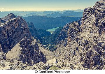 View of a lake through mountain pass.