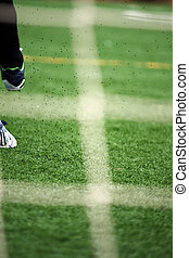 View of a leg kicking a ball