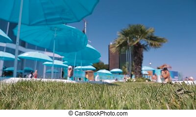 View of a luxury resort hotel with turquoise umbrella...