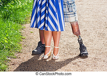 View of a man wearing a prosthetic leg - Close up view of...