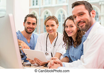 Medical team working at the hospital all together