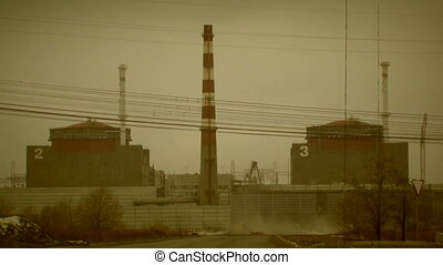 View of a nuclear power station - Power blocks, pipes, power...