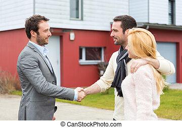 Real estate agent delivers keys to