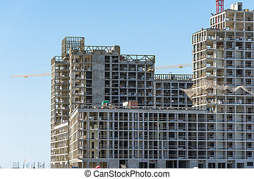 View of a residential complex under constructio. Large-scale building of the city