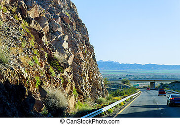 View of a road in desert with rock mountain