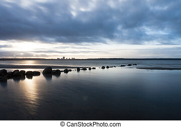 View of a rocky coast in the morning.