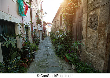 View of a small cozy street in the center of the old district of Porto, Portugal.