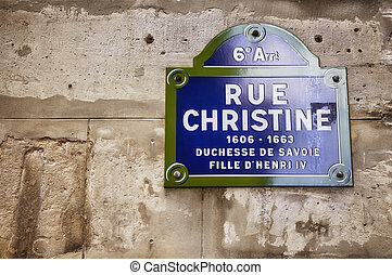 View of a street sign in Paris on old, stone wall