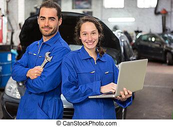 Team of mechanics working at the garage