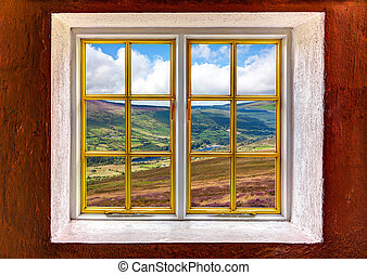 View of a vally and mountains through a window