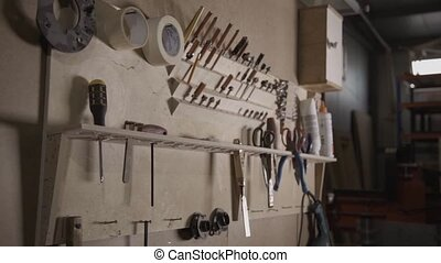 View of a wall with different work instruments in furniture factory