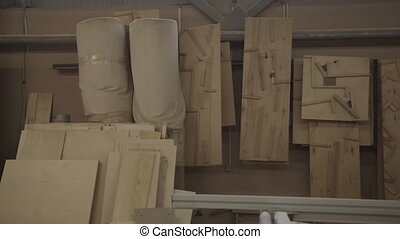 View of a wall with many wooden boards in furniture factory